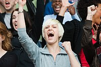 Woman cheering at football match