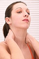 Young woman suffering from her neck and back