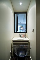 A small alcove in a city townhouse bedroom doubles as a home office.