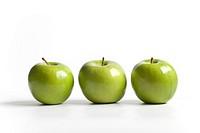 Three green shiny Granny Smith apples on a row