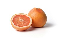 Whole and half grapefruit on white background
