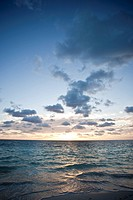 The sun rises above the Caribbean Sea in the Mexican Riviera.