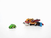 Toy electric vehicle and old cars.