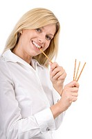 Woman eating pretzel sticks