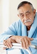 Elderly patient leaning on a walker