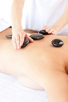 Caucasian woman having a stone therapy in a spa
