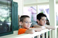 Two young boys gazing over railing