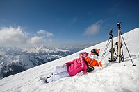 Skiers laying on mountain ski slope