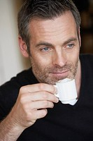 Man having espresso