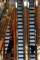 Man is standing on the escalator at Trump Tower in New York