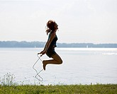 Girl jumping with rope