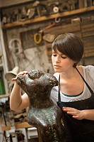 Artist working on sculpture