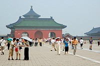 Groups of people visiting the Temple of Heaven during an afternoon in Beijing, China.