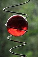Magical red glass ball in a spiral