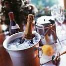 Ice bucket of champagne on a Christmas table setting