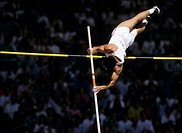 Male Pole Vaulter clears bar at meeting