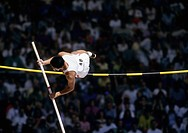 Male Pole Vaulter hits bar at meeting