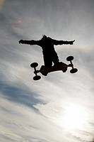Man jumping on a dirt board