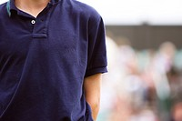 Ball Boy in a polo shirt at a tennis match