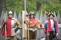 English reenactor soldiers firing guns at James Fort, Jamestown Settlement, on the 400th Anniversary of Jamestown, Virginia, May 4, 2007