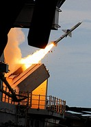 EAST CHINA SEA Sept  21, 2010 A RIM 7P Sea Sparrow missile is fired from the forward missile launcher aboard the forward-deployed amphibious assault s...