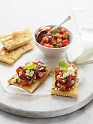 Flatbread topped with tomato salsa and feta