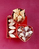 Nougat hearts, Wickelkind biscuits yeast biscuits filled with vanilla buttercream and calissons d´Aix almond confectionary