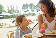 Woman and her son eating at a restaurant