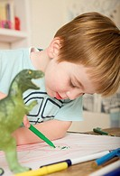 Boy drawing and coloring