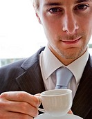 Close up of a young businessman having a coffee