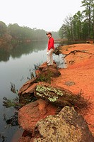 Hiker Looking Out Over Foggy Lake - Bastrop State Park, Texas