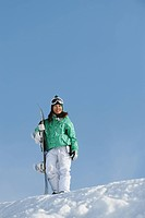 Woman Standing with Snowboard on Snowfield