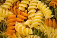 Extreme close_up of rotini noodles.