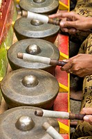 Balinese playing gongs, an instruments used in gamelan music, Bali, Indonesia.