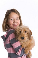 Portrait Of A Little Girl And Her Pet Dog On White Background