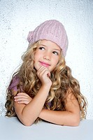Smiling gesture little girl winter pink cap portrait silver background