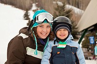 red deer, alberta, canada, a mother with her young son at a ski area