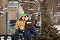 red deer, alberta, canada, a man and woman riding a chair lift at a ski area