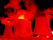Cooling towers. Thermogram of water vapour rising out of cooling towers at a power station. Thermography records surface temperatures by detecting the...