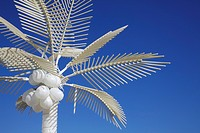 plastic palm tree on messina beach, messina, sicily, italy