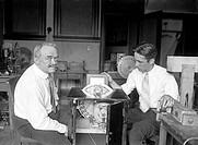 Charles Francis Jenkins 1867_1934, left, American inventor and cinema pioneer, demonstrating one of his projectors. Jenkins undertook the first public...