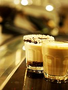 Two glasses with cafe background