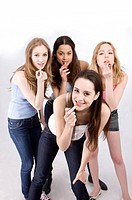 Four young women applying lipstick (thumbnail)