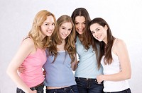 Portrait of four young women smiling happily