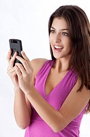 Young woman looking at mobile phone happily