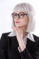 Young businesswoman wearing glasses, thinking with head on hand