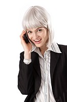 Young businesswoman talking on the phone happily