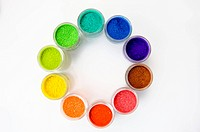 Different colors of paint in jars forming a circle