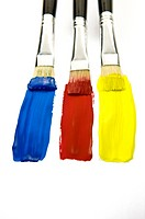 Three Paintbrushes with colors of Blue, Red, and Yellow