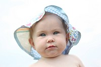 Baby girl in floppy sun hat